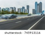 empty asphalt road front of... | Shutterstock . vector #745913116