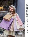 enjoying shopping day. vertical ... | Shutterstock . vector #745913758