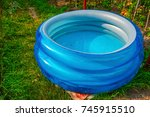 Plastic Pool In A Summer Day...