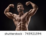 portrait of strong athletic... | Shutterstock . vector #745921594