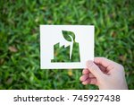 hands holding cut paper with... | Shutterstock . vector #745927438