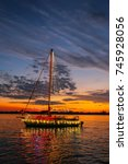 A Decorated Sailboat Cruises...