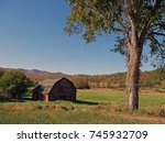 A Rustic Red Barn With The...