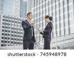boss explaining something to... | Shutterstock . vector #745948978
