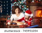 mother and daughter baking... | Shutterstock . vector #745951054