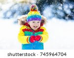 child playing with snow in... | Shutterstock . vector #745964704