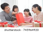 happy asian little girl with...   Shutterstock . vector #745964920
