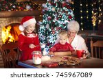 grandmother and children baking ... | Shutterstock . vector #745967089