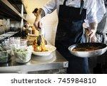 chef cooking spaghetti in the...   Shutterstock . vector #745984810
