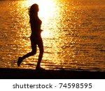 young girl jogging on the beach | Shutterstock . vector #74598595