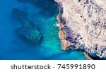 sea rocks beach light | Shutterstock . vector #745991890