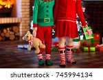 children at christmas tree and... | Shutterstock . vector #745994134