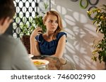 unhappy pretty young woman... | Shutterstock . vector #746002990