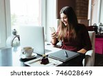 young attractive woman sitting... | Shutterstock . vector #746028649