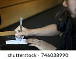 consumer woman signing on a... | Shutterstock . vector #746038990