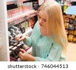 positive female customer... | Shutterstock . vector #746044513