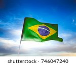 brazil flag waving with pride... | Shutterstock . vector #746047240