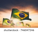 brazil flags waving with pride... | Shutterstock . vector #746047246