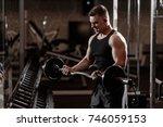young bodybuilder makes... | Shutterstock . vector #746059153