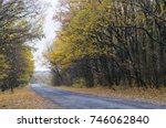 narrow road in the autumn forest | Shutterstock . vector #746062840