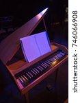 Small photo of grand piano in theater