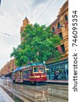 Small photo of MELBOURNE - NOVEMBER 2015: City tram along the streets on a rainy day. Trams are a tourist attraction among tourists.