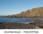 dramatic cliffs and beach at... | Shutterstock . vector #746105566