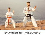 man and boy doing karate poses... | Shutterstock . vector #746109049