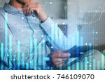 businessman using tablet at... | Shutterstock . vector #746109070