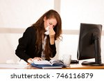 il woman suffering at work in... | Shutterstock . vector #746116879