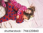 children in pajamas happy smile ... | Shutterstock . vector #746120860
