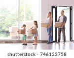 family with cardboard boxes... | Shutterstock . vector #746123758