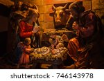 Small photo of COLMAR, FRANCE - JANUARY 3, 2017: Christmas Nativity scene in Cathedral. Statues of Nativity scene: Holy Mary, Saint Joseph, angels looking at baby Jesus lying in manger.