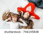 children listen to music on... | Shutterstock . vector #746145838