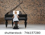 Little Girl Playing Piano...