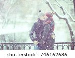 young man and woman in the snow ...   Shutterstock . vector #746162686