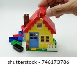 Lego blocks to be assembled to build a house isolated on white background.