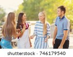 happy teenagers on city street | Shutterstock . vector #746179540