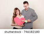 smiling young couple holding... | Shutterstock . vector #746182180