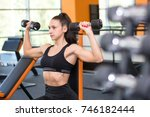 girl with dumbbells in the gym | Shutterstock . vector #746182444