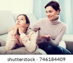 young mother persuades daughter ...   Shutterstock . vector #746184409