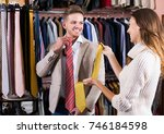 young smiling couple deciding... | Shutterstock . vector #746184598