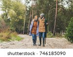 happy couple in raincoats with... | Shutterstock . vector #746185090