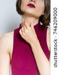 beautiful young woman has sore... | Shutterstock . vector #746209000