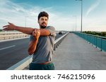 man stretching before his run | Shutterstock . vector #746215096