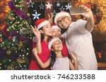 asian family taking a selfie... | Shutterstock . vector #746233588