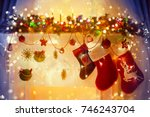 christmas stocking on fireplace ... | Shutterstock . vector #746243704