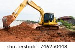 the backhoe working in the... | Shutterstock . vector #746250448