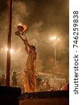 Small photo of October 13,2017. Varanasi,Uttar Pradesh,India. Young priest performing Evening Ganga Aarti puja celebration at Varanasi ghat. . Selective focus is used.