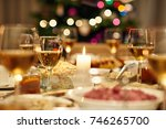 warm dining table full of a... | Shutterstock . vector #746265700